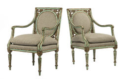 Green painted distressed arm chairs with old gilding Royalty Free Stock Image