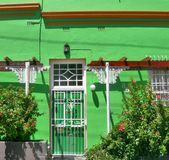 Green painted house with white window  in Bo-Kaap , Cape Town , South Africa Royalty Free Stock Photography