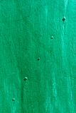 Green painted metal sheet with rivets diagonally Stock Photo