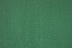 Green painted metal surface closeup as background Stock Photos