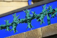 Steel security spikes on wall. Green painted security spikes on top of wall at industrial site in England royalty free stock photos