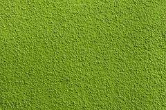 Green painted stucco wall. Royalty Free Stock Image