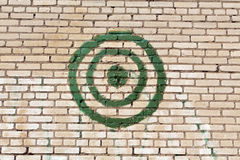 Green painted target on brick wall. Stock Photos