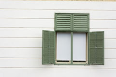 Green painted window with white wall Stock Images