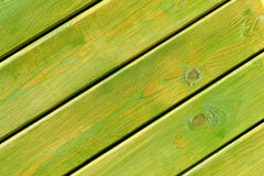 Green painted wooden planks close-up. Textured background stock photo