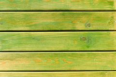 Green painted wooden planks close-up textured background. Outdoor shot royalty free stock photo