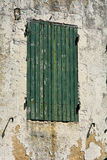 Green painted wooden window shutters. On French home Royalty Free Stock Photography
