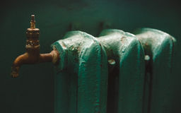 The Green Paited  Old Iron Battery with Yellow Copper Tap;Toned Royalty Free Stock Photo