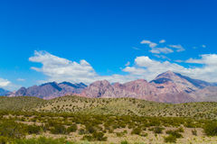 Green palin, river and high mountains above Royalty Free Stock Photos