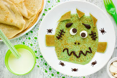 Green pancake - creative idea for funny and healthy breakfast fo Royalty Free Stock Photos