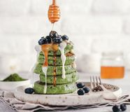 Green pancakes with matcha tea royalty free stock images