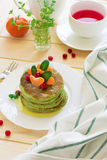 Green pancakes with spinach and bananas decorated citrus, mint and cranberry Royalty Free Stock Photo