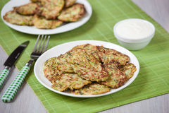 Green pancakes with zucchini and herbs Stock Photography