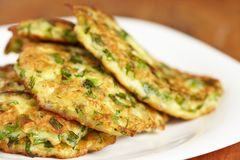 Green pancakes with zucchini and herbs Royalty Free Stock Photo