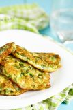 Green pancakes with zucchini and herbs Stock Photos