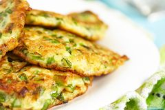 Green pancakes with zucchini and herbs Stock Images