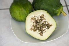 Green papaya. Fresh green papaya makes amazing salad Royalty Free Stock Images
