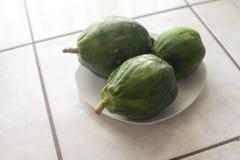 Green papaya. Fresh green papaya makes amazing salad Stock Photos