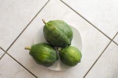 Green papaya. Fresh green papaya makes amazing salad Stock Images