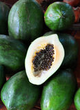 Green Papaya Fruit. Background taken at the Hoi An market in Vietnam. This large tropical fruit  is popular throughout Asia in two varieties - green and yellow Royalty Free Stock Photos