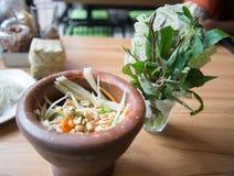 Green papaya salad. Delicious in a mortar Royalty Free Stock Photography