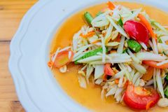 Green papaya saladsomtum. Green papaya salad with dish stock images