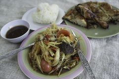 Green papaya salad, grilled chicken. And sticky rice Royalty Free Stock Photography
