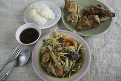 Green papaya salad, grilled chicken. And sticky rice Stock Image
