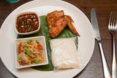 Green papaya salad, grilled chicken and sticky rice Stock Photos