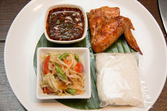 Green papaya salad, grilled chicken and sticky rice Royalty Free Stock Images