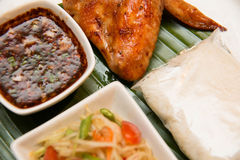 Green papaya salad, grilled chicken and sticky rice Stock Photo