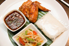 Green papaya salad, grilled chicken and sticky rice Royalty Free Stock Photo
