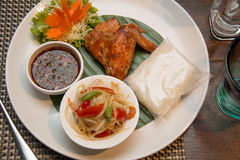 Green papaya salad, grilled chicken and sticky rice Royalty Free Stock Photography