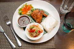 Green papaya salad, grilled chicken and sticky rice Stock Images