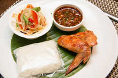 Green papaya salad, grilled chicken and sticky rice. A Green papaya salad, grilled chicken and sticky rice Stock Images