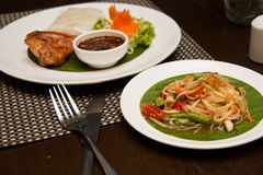 Green papaya salad, grilled chicken and sticky rice Royalty Free Stock Photos