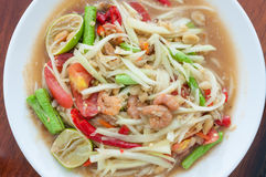 Green papaya salad hot and spicy thai cuisine. Som tum thai speak Royalty Free Stock Image