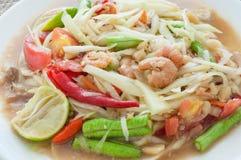 Green papaya salad hot and spicy thai cuisine. Som tum thai speak Stock Photo