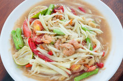 Green papaya salad hot and spicy thai cuisine. Som tum thai speak Stock Photos