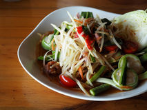 Green papaya salad with pickled mussels Royalty Free Stock Photo