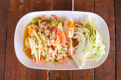 Green papaya salad with salted egg on wood table. Original spicy thai food Stock Photos