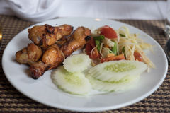 Green Papaya salad Som tum with grilled chicken. On dish stock images