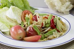 Green papaya Salad Som Tum Thai and sticky rice in bamboo cont. Ainer, Thai food royalty free stock image