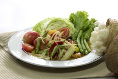 Green papaya Salad Som Tum Thai and sticky rice in bamboo cont. Ainer on white background, Thai food stock photos