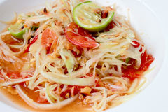 Green Papaya Salad (Som tum Thai) on table. Thai cuisine spicy delicious. Royalty Free Stock Images