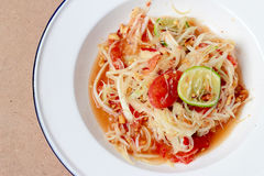 Green Papaya Salad (Som tum Thai) on table. Thai cuisine spicy delicious. Stock Photography