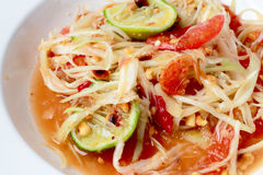 Green Papaya Salad (Som tum Thai) on table. Thai cuisine spicy delicious. Stock Photos