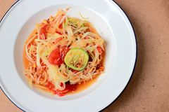 Green Papaya Salad Som tum Thai on table. Thai cuisine spicy delicious. Stock Photos