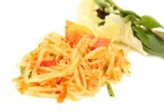 Green papaya salad  spicy isolated. On white background Stock Photo