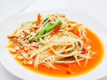 Green papaya salad. Is a spicy salad made from shredded unripe papaya. Probably originating from ethnic Lao peoples living in present-day Thailand, it is also Stock Photos